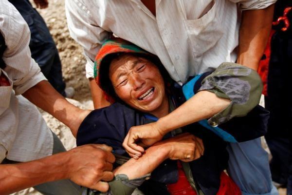 Kinijoje valdžia iš namų prievarta iškeldinėja žmones