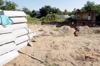 Sodai virsta gyvenamųjų namų kvartalais