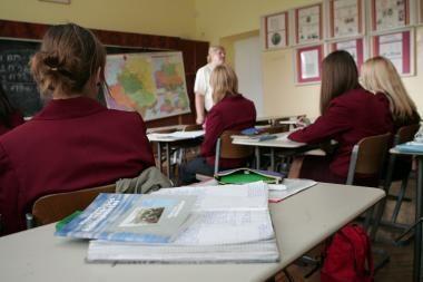 Į mokyklas neateinančių mokinių skaičius mažėja