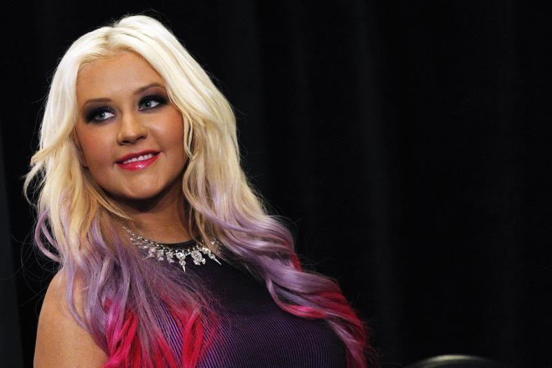 """Ch. Aguilera savo nemenkus apvalumus aptempė """"antra oda"""" (foto)"""