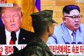 Donaldas Trumpas (kairėje) ir Kim Jong Unas