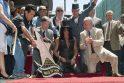 """Buvęs """"Guns N'Roses"""" gitaristas Slashas pagerbtas žvaigžde Holivude"""