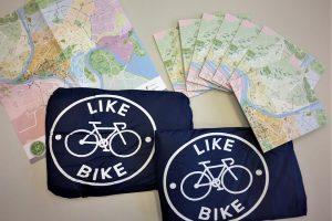 Su dviračiu – ir per lietų: kur gauti nemokamą lietpaltį?