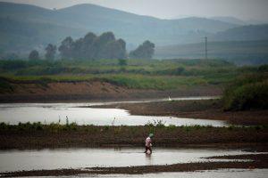 Šiaurės Korėjoje potvynių aukų padaugėjo iki 133, dingę šimtai žmonių