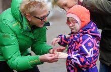 Olimpinę čempionę sujaudino sergančios mergaitės mamos stiprybė